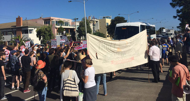 Protesters block buses heading to Q Society meeting. Photo: Twitter.